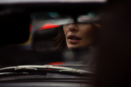 view_of_girl_through_car_windscreen