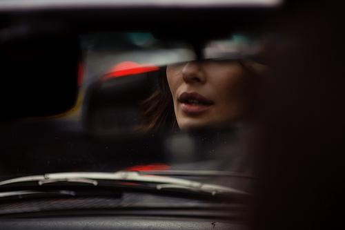 view_of_girl_through_car_windscreen